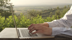 Businessman Using Laptop Oudoors Stock Footage
