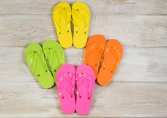 new sandals placed on faded wood - stock photo