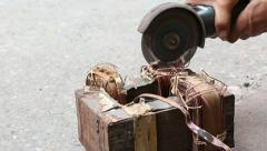 A working man using an electric grinder for Electric Waste Separated Stock Footage