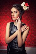 Woman in leather on red vintage interior Stock Photos