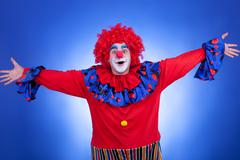 Happy clown on blue background Stock Photos