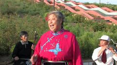 Stock Video Footage of Chinese aunt singing 'Er ren tai'