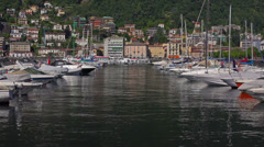 Italy, lake Como,  boats and yachts moored to pier. Stock Footage