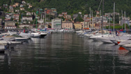 Stock Video Footage of Italy, lake Como,  boats and yachts moored to pier.