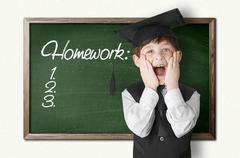 Cheerful little boy on blackboard. Looking at camera - stock illustration