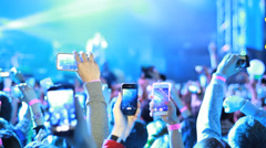 Fans waving their hands and hold the phone with digital displays. Stock Footage