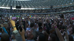 Fans Shine flashlights, cheering during a rock concert Stock Footage