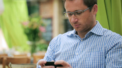 Man using cellphone in restaurant, steadycam shot Stock Footage