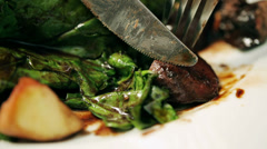 Meat cutting by knife, steadycam shot, closeup Stock Footage