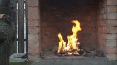 Fire burning outside in the bricks oven ready for barbecue nice flames view Stock Footage