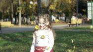 Stock Video Footage of Girl playing with leaves