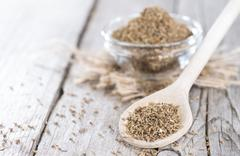 Dried aniseed on a wooden spoon Stock Photos