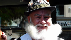 Bavarian man in costume carrying white beard smiling Munich Germany Europe Stock Footage