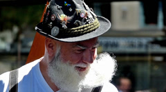 Slow Motion Bavarian man in costume carrying white beard smiling Munich Germany Stock Footage