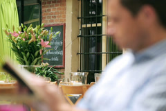Blurred man sitting in restaurant, steadycam shot Stock Footage