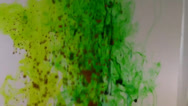 Stock Video Footage of Green, yellow dye in water