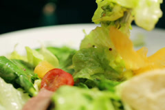 Someone eating healthy food, closeup, steadycam shot Stock Footage