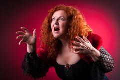 woman playing bad witch - stock photo
