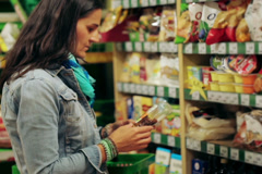 Woman shopping in delicatessen, steadycam shot - stock footage