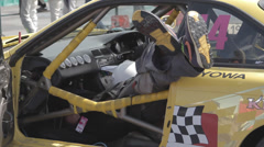 Racer repairs race car Stock Footage