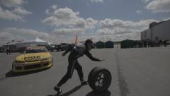Racer running with wheel on parking Stock Footage
