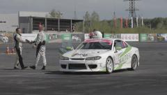 Racers embraces on race track Stock Footage
