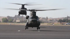 California Army National Guard helicopters take off in formation Stock Footage