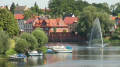 Havelberg, City scene with river Havel and boats Stock Footage