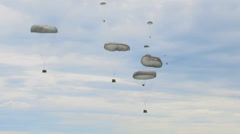 Parachuting out of a C-130 Hercules transport aircraft Stock Footage