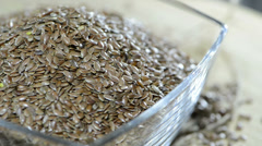 Portion of flaxseeds (not loopable) Stock Footage
