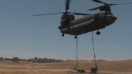 Stock Video Footage of CH-47 Chinook helicopter Conducts Sling Load Training