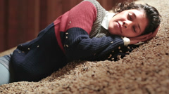 Woman asleep in huge coffee pile - stock footage