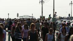 Busy crowd on Brighton promenade Stock Footage