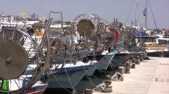 Fishing reels on boats in Paphos harbor Stock Footage