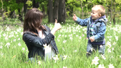 Agreement gesture, adorable child and mother have fun in nature, OK sign Stock Footage