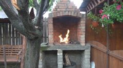 Nice fire house in the garden orange flames burning in oven place to relax, cook Stock Footage
