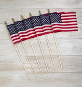 United of america flags on white faded wood Stock Photos