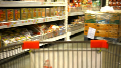 Customer shopping at supermarket with trolley. Video shift motion - stock footage