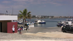People walking up the road near Paphos harbor Stock Footage