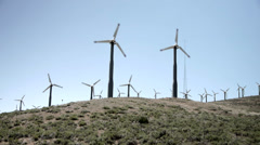 Wind Turbine field creating energy in california - stock footage
