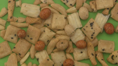 Rice crackers on a green background. - stock footage