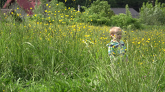 Sweet boy is the grass, plant bigger than child, height grass   Stock Footage