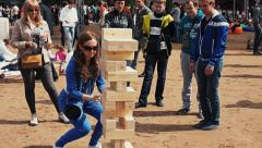 Big Jenga game. Wooden building blocks, bricks. Giant tower. - stock footage