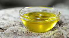 Flaxseed oil (loopable video) Stock Footage