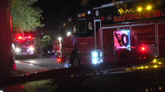 Firefighter and several firetrucks night Stock Footage