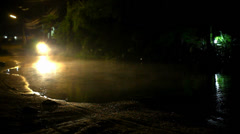 Motorbike drives through a puddle on the road at night after rain. Video Stock Footage