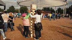 Big Jenga game. Wooden building blocks, bricks. Giant tower. Fall Stock Footage