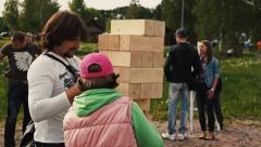 Big Jenga game. Wooden building blocks, bricks. Giant tower. Stock Footage