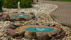 Decorative fountains in the garden. 4K. Stock Footage