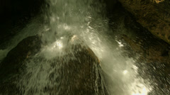 Small waterfall and stone closeup Stock Footage